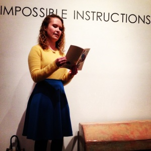 Rachel Milligan reading her work in front of Dylan Pecora's work (& our show's title!)